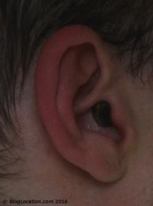 11_wearing_foam_ear_plug_cut_and_painted_black_side_view