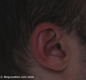 12_yellow_white_bilsom_303_foam_ear_plugs_cut_and_painted_side_view_wearing